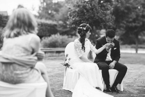 Groom kisses bride's hand