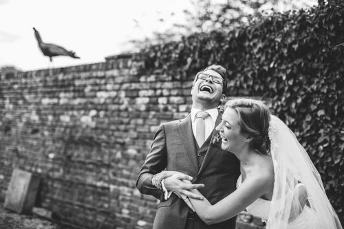 Wedding couple laughs